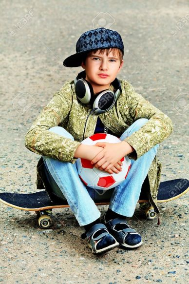 13320392-portrait-of-a-trendy-boy-teenager-with-skateboard-and-ball-outdoors-stock-photo
